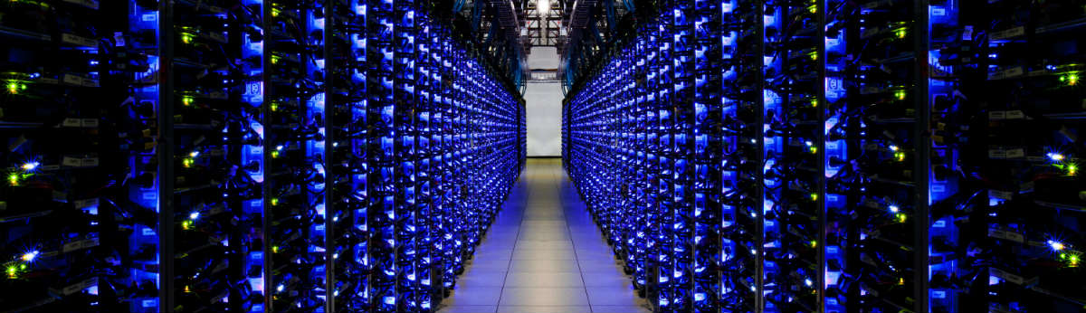 Google's datacenter, lit by thousands of blue LEDs from the servers' status panels.